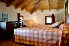 Double rooms with wooden furniture